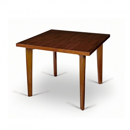 "Pierre JEANNERET. Table en teck massif et placage de teck dite ""Dining table""."