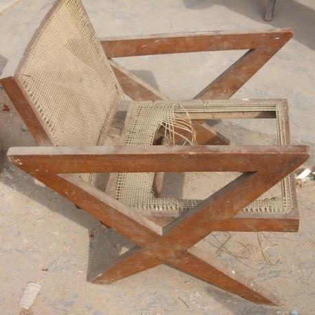 """Pierre JEANNERET. Fauteuil dit """"Cross easy chair"""" en teck massif et cannage tressé."""