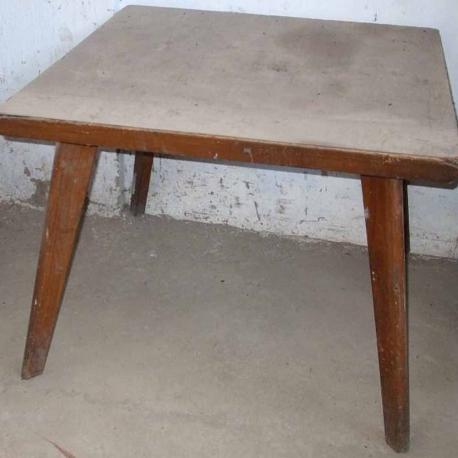 """Pierre JEANNERET. Table en teck massif et placage de teck dite """"Dining table""""."""