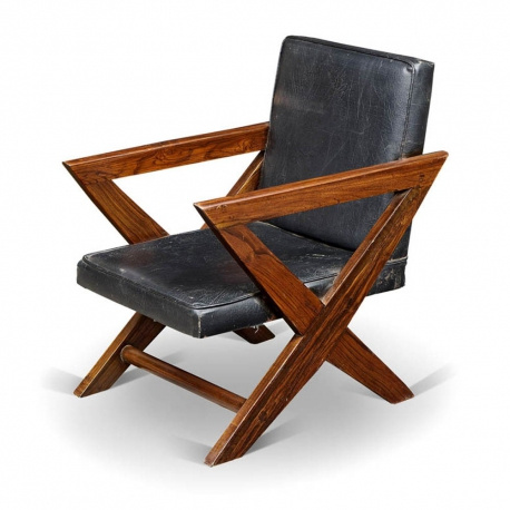 Pierre JEANNERET. Armchair in solid teak and imitation leather.