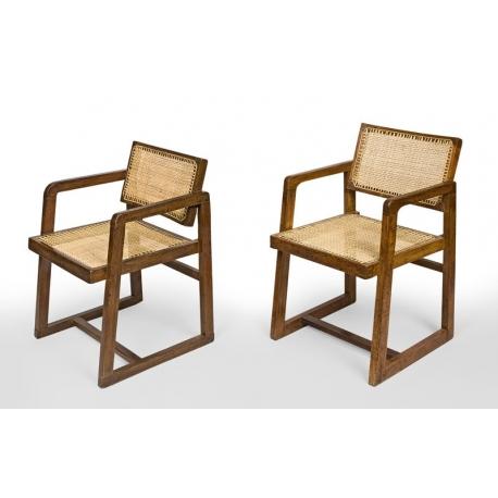 """Pierre JEANNERET. Fauteuil dit """"Cane seat cane back office chair"""", en teck massif avec assise et dossier en cannage tressé."""